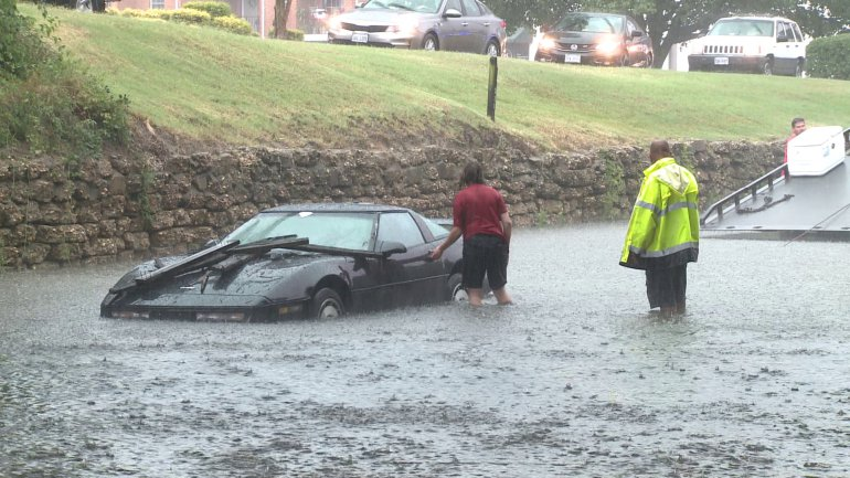 Woman Narrowly Escapes Falling Debris While Trying to Tow Flooded Corvette